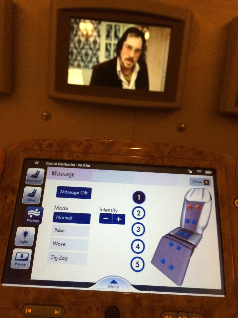 Enjoying my Massage + Movie in flight